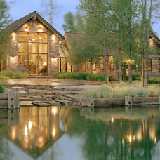 Rustic Exterior by JLF & Associates, Inc.