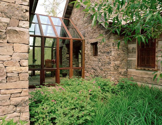 Rustic Exterior by JLF & Associates, Inc.