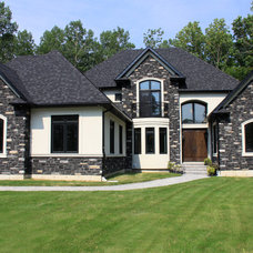 Traditional Exterior by Custom CADD Inc
