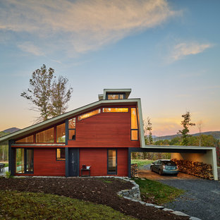 Inspiration for a mid-sized modern gray three-story mixed siding house exterior remodel in Other with a hip roof and a green roof