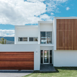 This is an example of a contemporary two-storey white house exterior in Wollongong with mixed siding and a flat roof.