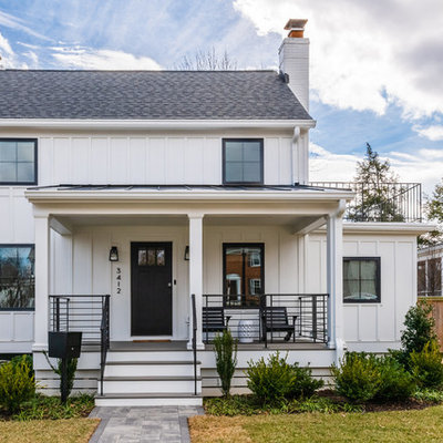 Mid-sized transitional white two-story wood exterior home photo in DC Metro with a shingle roof