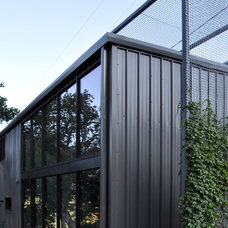 Industrial Exterior by MICHAEL HENNESSEY ARCHITECTURE