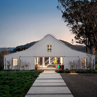 Example of a country white two-story exterior home design in San Francisco