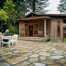 Rustic Exterior by 450 Architects, Inc.