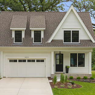 Example of a transitional white two-story wood house exterior design in Minneapolis with a shingle roof