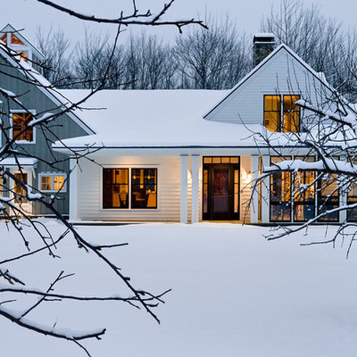 Inspiration for a mid-sized cottage two-story wood gable roof remodel in Portland Maine