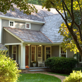 Traditional brown exterior home idea in DC Metro with a shingle roof