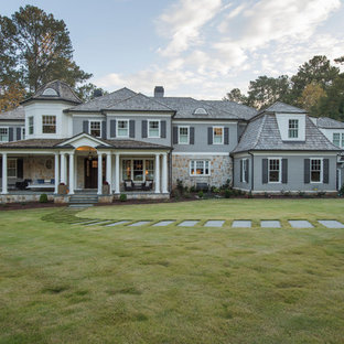 Inspiration for a timeless gray two-story exterior home remodel in Atlanta with a hip roof and a shingle roof