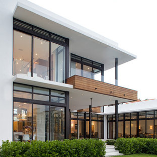 Inspiration for a white contemporary two floor exterior in Miami.