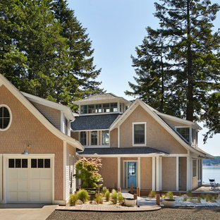 Coastal beige two-story exterior home idea in Seattle