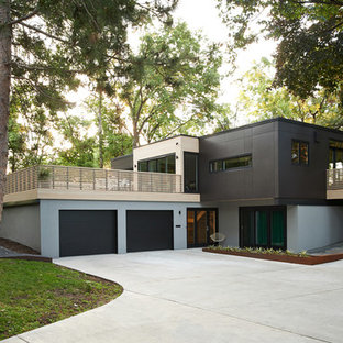 Large minimalist two-story mixed siding flat roof photo in Minneapolis