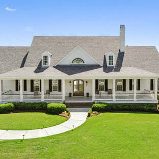 Inspiration for a country white two-story house exterior remodel in Other with a shingle roof
