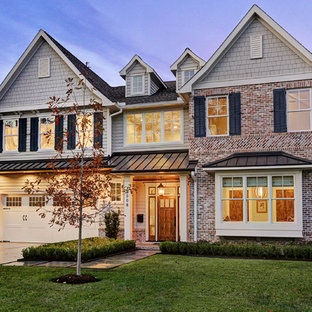Elegant multicolored two-story mixed siding exterior home photo in Houston with a mixed material roof
