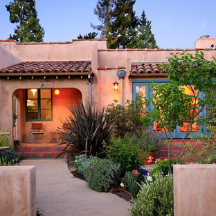 Inspiration for a small southwestern one-story adobe exterior home remodel in San Francisco