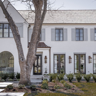 Large transitional white two-story brick exterior home idea in Dallas with a shingle roof