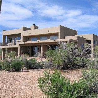 Inspiration for a mid-sized southwestern two-story adobe exterior home remodel in Phoenix