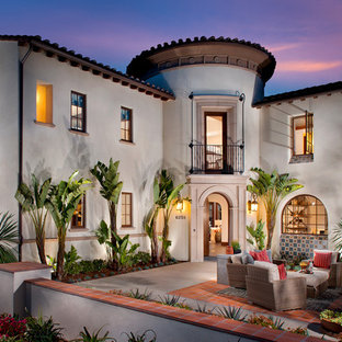 Inspiration for a large southwestern beige two-story stucco exterior home remodel in San Diego