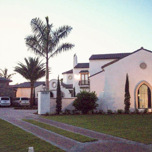 Example of a tuscan exterior home design in Miami