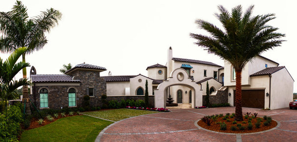 Mediterranean Exterior by Period Style Homes Plan Sales, Inc