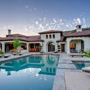 Example of a huge tuscan exterior home design in Los Angeles