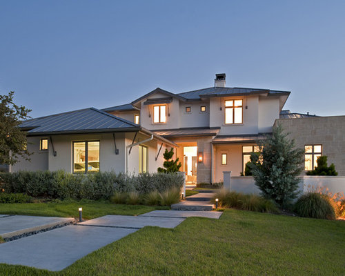 Contemporary Two Story Exterior Home Idea In Austin With A Metal Roof