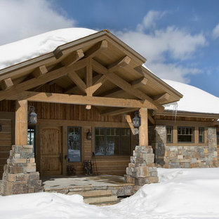 Large mountain style brown one-story wood house exterior photo in Other