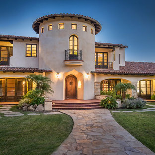 Huge tuscan beige two-story gable roof photo in Los Angeles