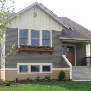 Mid-sized traditional gray two-story wood gable roof idea in Minneapolis
