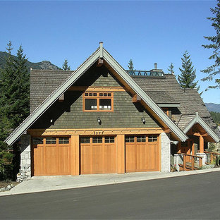 Large Mountain Style Green Three Story Wood Exterior Home Photo In  Vancouver With A Gambrel