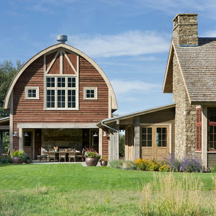Country two-story wood exterior home idea in Other