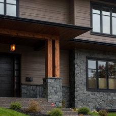 Transitional Exterior by Metropolitan Custom Homes Calgary
