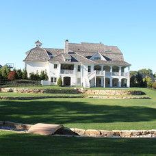Farmhouse Exterior by Stacye Love Construction & Design, LLC