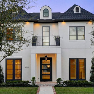 Mid-sized transitional white two-story concrete house exterior idea in Houston with a hip roof and a shingle roof