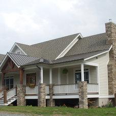 Farmhouse Exterior by Christopher Kellie Design Inc.