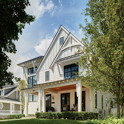 Example of a large transitional white two-story concrete fiberboard gable roof design in Detroit