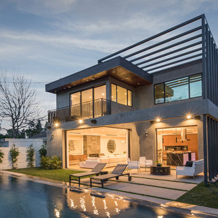 Large contemporary gray two-story concrete exterior home idea in Los Angeles