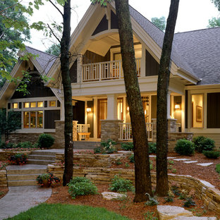 Inspiration for a huge timeless brown two-story stone exterior home remodel in Minneapolis
