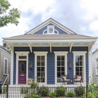 Small transitional blue one-story wood house exterior photo in New Orleans with a gambrel roof and a shingle roof