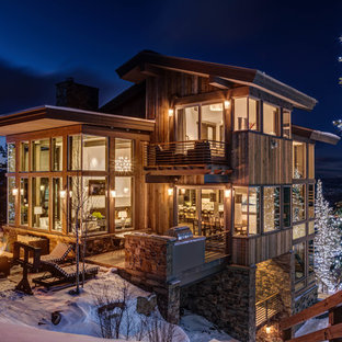 Example of a mountain style brown three-story wood exterior home design in Salt Lake City