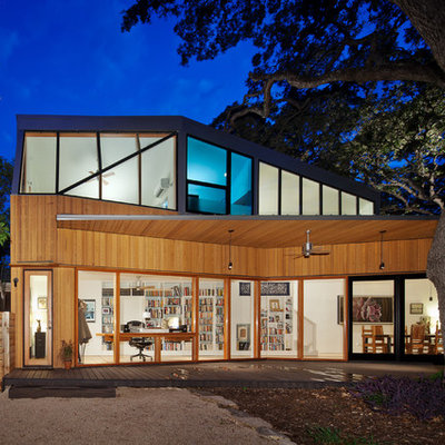 Example of a trendy two-story wood exterior home design in Austin
