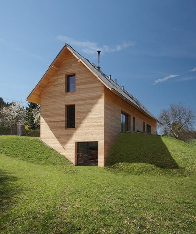 How to artfully build a house on a hillside for Building a house on a slope