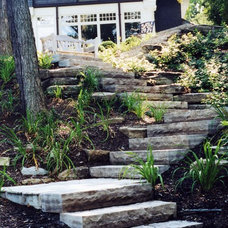 Rustic Exterior by Rockcliffe Landscaping