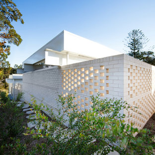 Inspiration for a modern white brick exterior home remodel in Sydney
