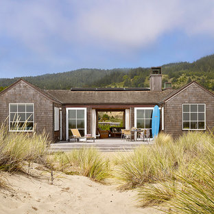 Design ideas for a small beach style one-storey exterior in San Francisco with wood siding and a gable roof.