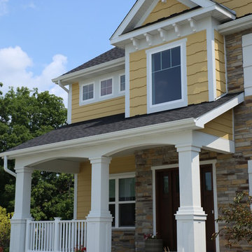 Stone and LP shake Custom home with covered front porch