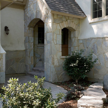 Stone and Stucco French Country Vacation Home Featuring Arch Top Stone Covered E