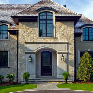 Stone and Stucco French Provincial with Arch Top White Oak Front Door