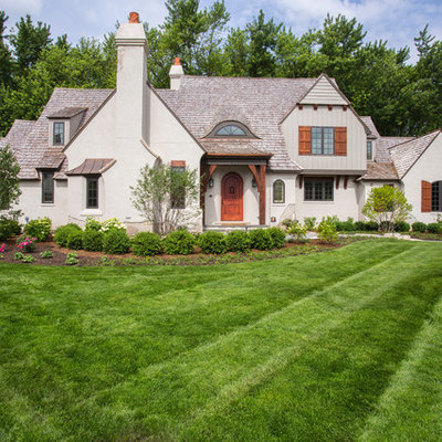 Huge elegant beige two-story stucco gable roof photo in Chicago