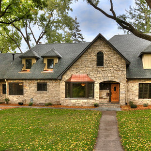 Example of a classic stone exterior home design in Minneapolis